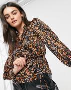 Vero Moda wrap blouse with ruffle trim in animal print-Multi
