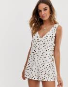 Tigerlily Gaia playsuit with button sides and low V back in white