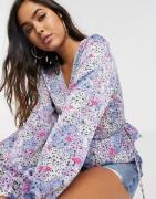 Vero Moda wrap blouse with peplum hem in blue floral-Multi